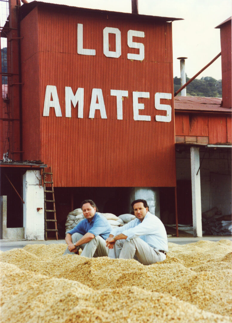 Howard Schultz with Starbucks coffee buyer, Dave Olsen, on a patio of drying coffee beans at a farm in Guatemala